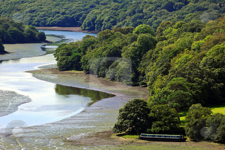 Peaceful Forest River stock photo, Peaceful Forest River with Narrow Boat in foreground at low tide by Robert Ford