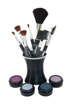 Cosmetics with brushes in stand stock photo, Eye shadow and blush with application brushes in stand, all isolated against a white backgrouns. by Steve Carroll