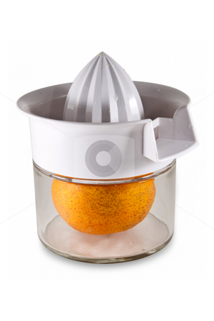 Fresh Orange Inside Juicer stock photo, Fresh orange inside of a hand juicer, isolated on a white background with clipping path. by Steve Carroll