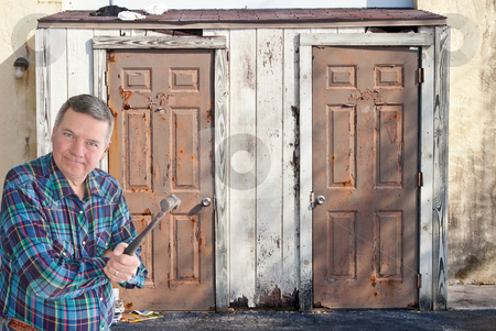 Mature handyman with hammer getting ready to tear down an old storage shed. stock photo, Mature handyman with hammer getting ready to tear down an old storage shed. by Steve Carroll