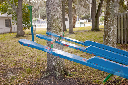 Old Teeter-Totter stock photo, An old teeter-totter in a disused playground. by Steve Carroll