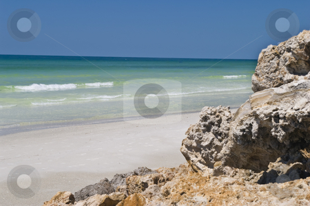 Boulders on Beach stock photo, Boulders placed on beach to prevent erosion. by Steve Carroll