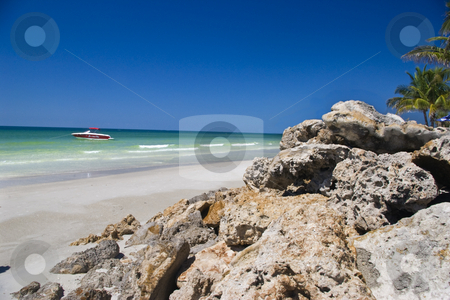 Boulders on Beach stock photo, Boulders placed on beach to prevent errosion. by Steve Carroll