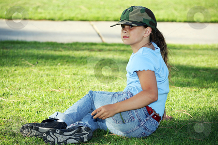 Backside of young girl stock photo, Young girl relaxing on the grass by Stacy Barnett