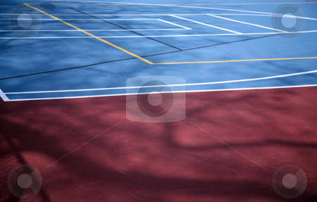 Basketball court stock photo, Man-made basketball court with a textured finish by Stacy Barnett