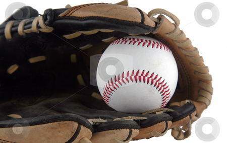 Baseball mitt stock photo, Brown baseball mitt with a white baseball in it by Stacy Barnett