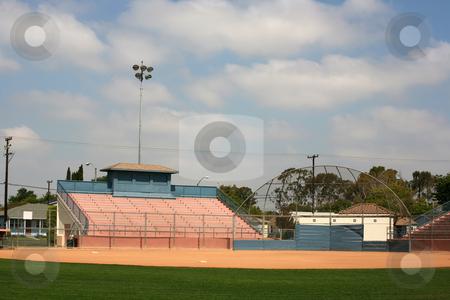 Backstop and stadium bleachers stock photo, Sports backstop and stadium bleachers ready for a softball or baseball game by Stacy Barnett