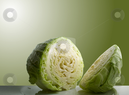Cabbage stock photo, Sliced cabbage with green background by Ira J Lyles Jr
