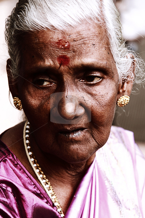 Old Indian Woman stock photo, Old Indian woman in deep thoughts. by Jimme Woudstra