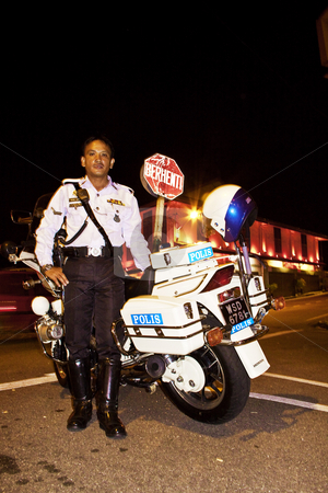 Police man in Malacca stock photo, Police man, policeman, bike, night, police, Malacca, Malaysia by Jimme Woudstra