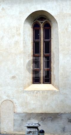 Gothic window stock photo, Old Gothic window with white gray facade by Juraj Kovacik