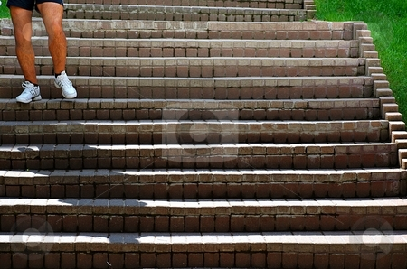 Mans legs stock photo, Mans legs on stairs with a shadow by Juraj Kovacik
