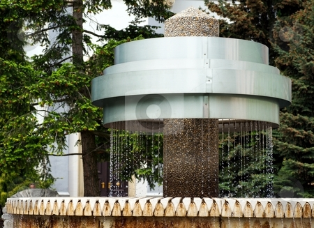 Metal fountain stock photo, Metal fountain with water in a park by Juraj Kovacik