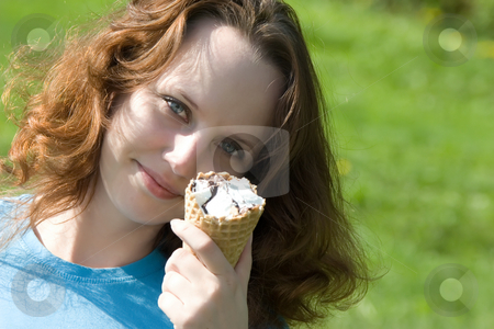 Yomg woman hold ice cream stock photo, Yomg woman hold ice cream by Andrey Butenko