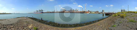 Pier and Steelworks Panorama stock photo, A harbor pier, with fishermen and a huge steel production plant on a lush summer afternoon by Corepics VOF