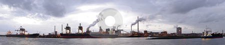 Steel works stock photo, The harbor of a steel plant, where ships with iron ore and coal are unloaded on an overcast evening by Corepics VOF