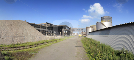 Industrial ruin and new factory stock photo, An industrial ruin and a newly erected factory side by side by Corepics VOF