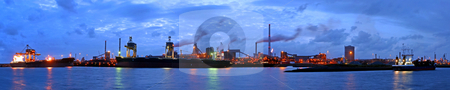 Steelworks at night stock photo, A panorama of a steel plant at twilight with huge ships being unloaded from their freight of iron ore and coal by Corepics VOF