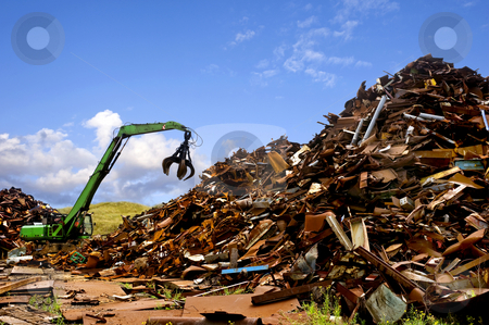 Steel recycling stock photo, A green digger, used to move metal scrap by Corepics VOF