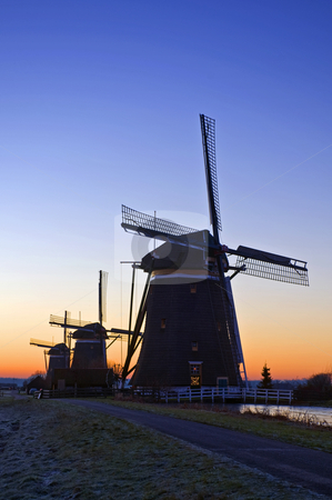 Three windmills stock photo, The three monumental windmills at Leidschendam, the Netherlands, neatly aligned on a beautiful winter dawn by Corepics VOF