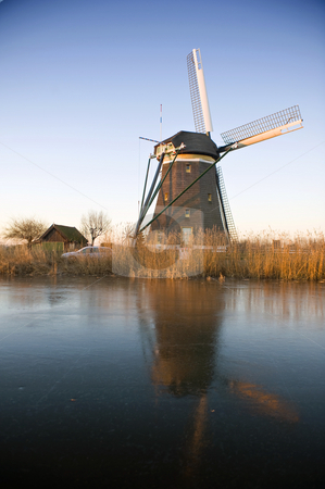 Windmill in the Morning Light stock photo, A typical Dutch windmill basking in the warm glow of the winter morning light by Corepics VOF