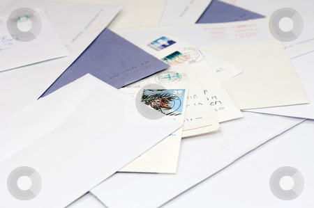 Pile of mail stock photo, A pile of envelops and postcards, bills on a doormat. by Corepics VOF