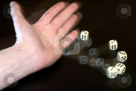 Throwing Dice stock photo, A male hand with a wedding ring throwing five dice by Corepics VOF