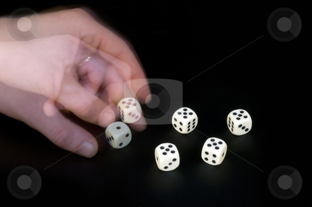 Cheating stock photo, A man's left hand turning the dice, cheating at a game by Corepics VOF