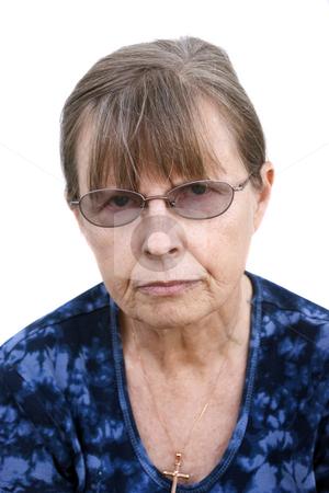 Stern looking mature female stock photo, Stern looking mature female, head & shoulder shot w/white background by Steve Carroll