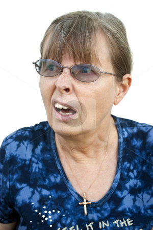 Confused Mature Lady stock photo, Headshot of a mature blond woman expressing confusion or surprise, on a white background by Steve Carroll