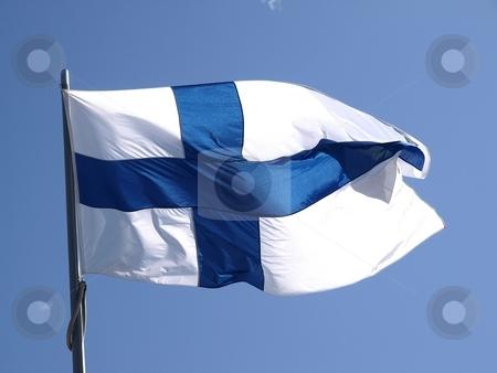 Finnish flag  stock photo, A finnish flag in the wind, blue sky by Lars Kastilan