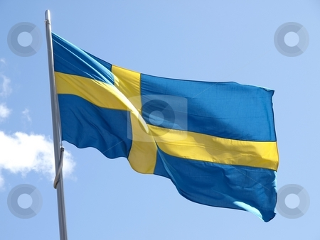Swedish flag  stock photo, Swedish flag in the wind, blue sky by Lars Kastilan