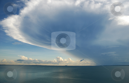 Storm Cloud Hovering stock photo, Storm clouding building and hovering over ocean by Emma White