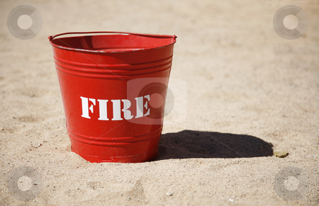 Fire stock photo, A shiny red fire bucket. by mdphot
