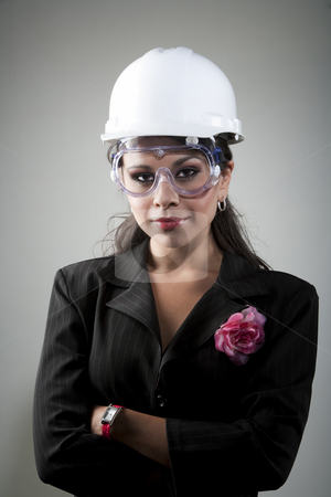 Young woman in hard hat and safety goggles stock photo, Handsome young woman in hard hat and safety goggles by Scott Griessel