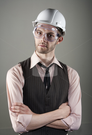 Young man in hard hat and safety goggles stock photo, Handsome young man in hard hat and safety goggles by Scott Griessel