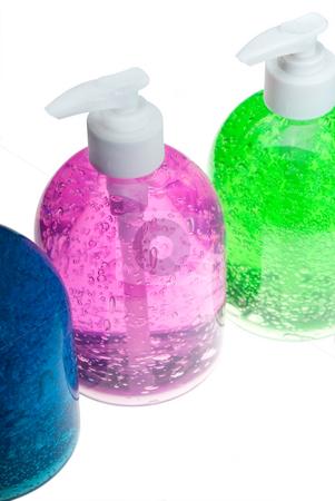 Hair gel bottles over white stock photo, Colorfull blue,pink and green hair gel bottles over white background by Francesco Perre