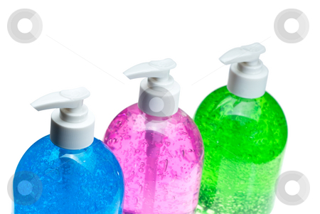 Hair gel bottles over white stock photo, Colorfull blue,pink and green hair gel bottles over white background by Francesco Perre