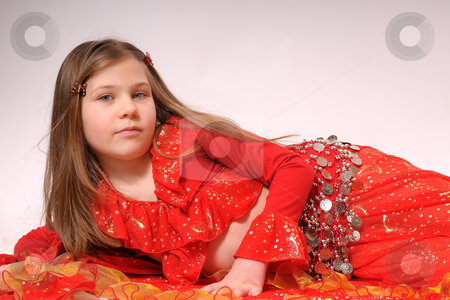 Gipsy girl stock photo, Portrait of gipsy girl with red dress by Dragos Iliescu
