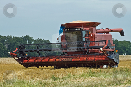 Farming Combine Ready For Action stock photo, Farming combine ready for action by Dennis Crumrin