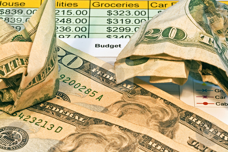 Money With Budget Chart stock photo, Money with budget chart by Dennis Crumrin