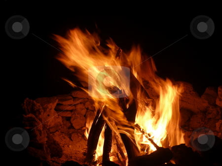 Night flames stock photo, Barbecue fire on beach at night by Fabrice Teboul