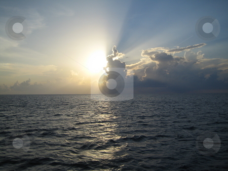 Carribean sunset stock photo, Carribean sunset from boat by Fabrice Teboul