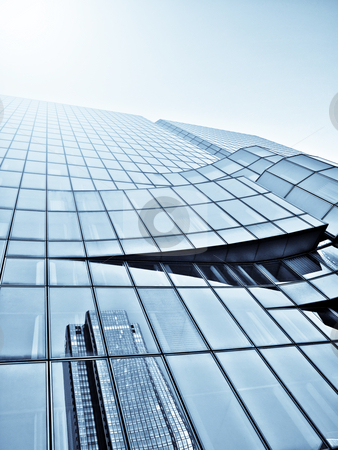 Skyscaper and sunlight stock photo, Modern glass skycraper with sunlight adn reflection by Laurent Dambies