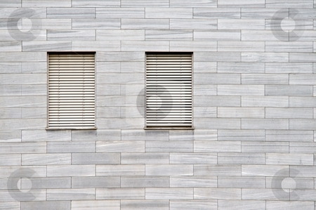 Stone facade with windows stock photo, Two windows with roles and stones facade by Juraj Kovacik