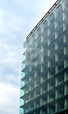 Skeleton and glass facade stock photo, Modern architecture, skeleton of building covered with glass facade by Juraj Kovacik