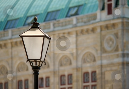 Lamp and facade stock photo, White black lamp with a historical facade in background by Juraj Kovacik