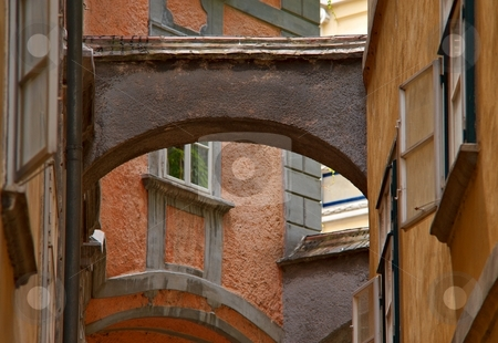 Old narrow street stock photo, Old town narrow street with a arc by Juraj Kovacik