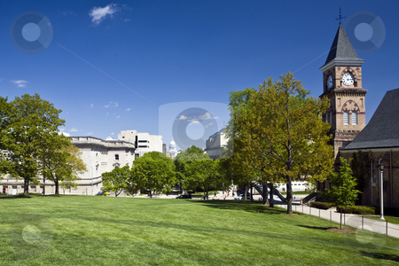 University of Wisconsin campus and state capitol building at Mad stock photo, Lush green lawn and trees at the UW campus in Madison, Wisconsin, contrasts with the state capitol building in the distance. by Bart Everett