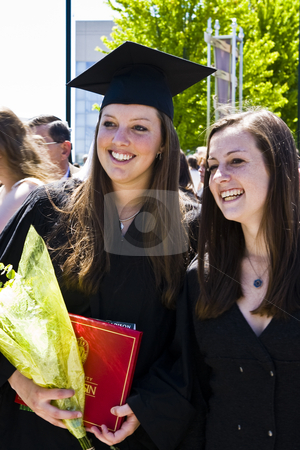 Happy Graduates stock photo, Young women smile after a college commencement ceremony by Bart Everett